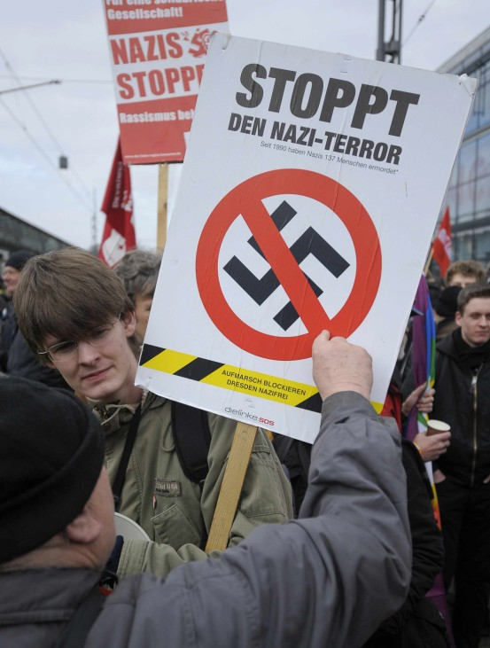 Left-wing demonstrators take part in a march against neo-Nazis in Dresden