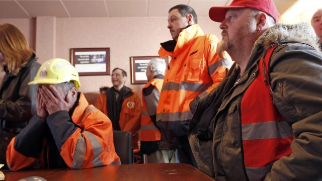 Employees of ArcelorMittal take part in the occupation of the local headquarters of the company in Florange