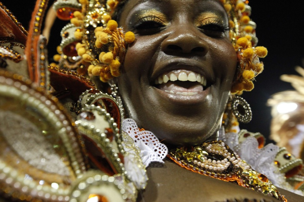 A reveller from the Salgueiro samba school takes part in the parade on the second night of the annual Carnival parade in Rio de Janeiro's Sambadrome