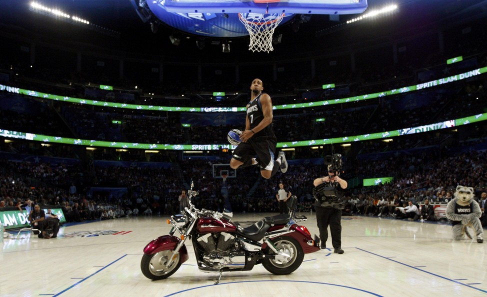 Timberwolves' Williams dunks over a motorcycle while competing in the slam dunk contest during the NBA All-Star weekend in Orlando