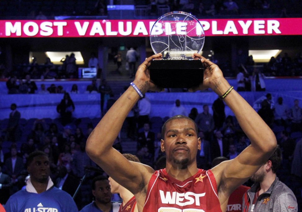 West All-Star Kevin Durant of the Oklahoma City Thunder holds up the MVP trophy after the NBA All-Star game in Orlando