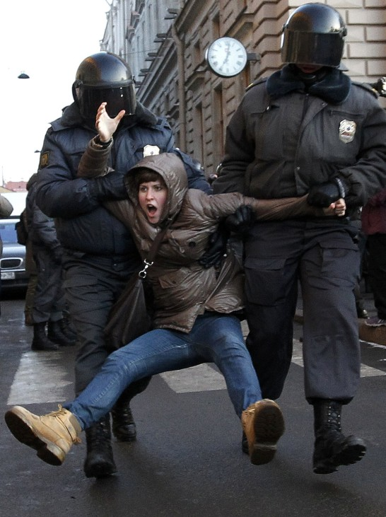 Russian police detain a participant during an opposition rally in St.Petersburg