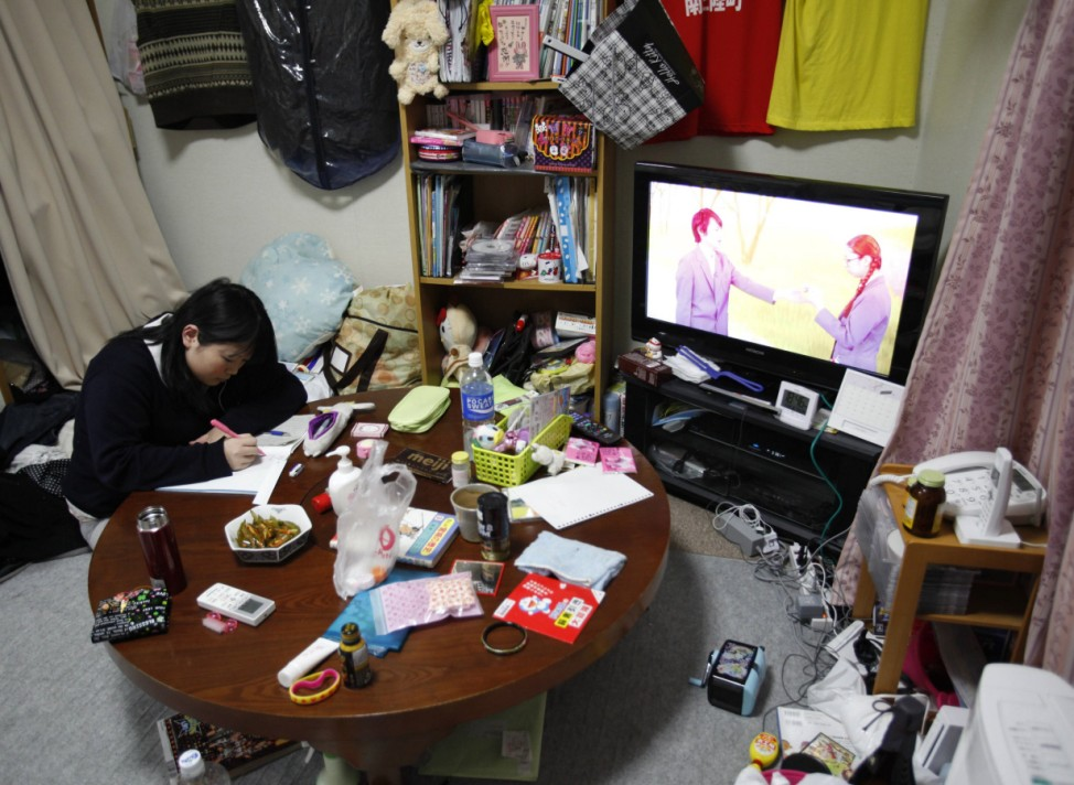 Satomi Watanabe, 17, studies at her temporary house