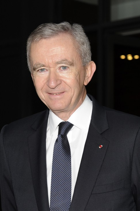 File photo of LVMH Chief Executive Bernard Arnault arriving for a news conference to present the group's 2010 results in Paris