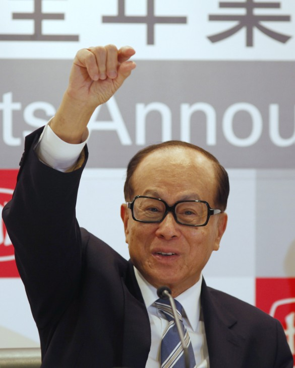 Hutchison Whampoa Chairman Li Ka-shing answers a question during a news conference announcing the company's annual results in Hong Kong