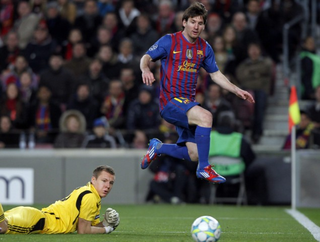 Barcelona's Messi scores his fourth goal past Bayer Leverkusen's goalkeeper Leno during their Champions League soccer match in Barcelona