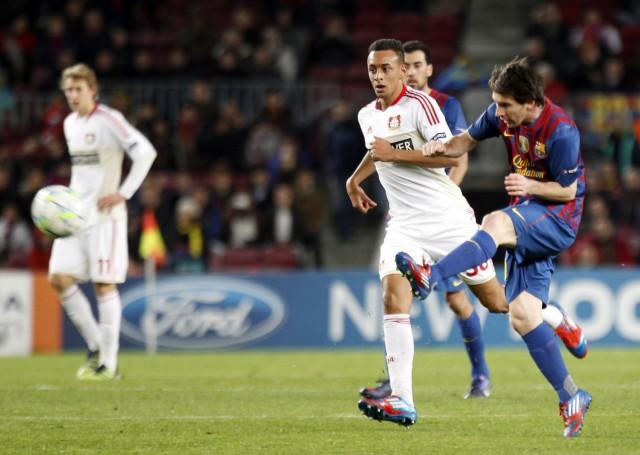 Barcelona's Messi kicks the ball past Bayer Leverkusen's Bellarabi during their Champions League soccer match in Barcelona