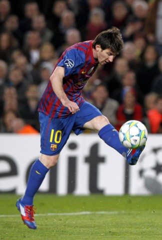 Barcelona's Messi kicks the ball to score a goal against Bayer Leverkusen during their Champions League last 16 second leg soccer match in Barcelona