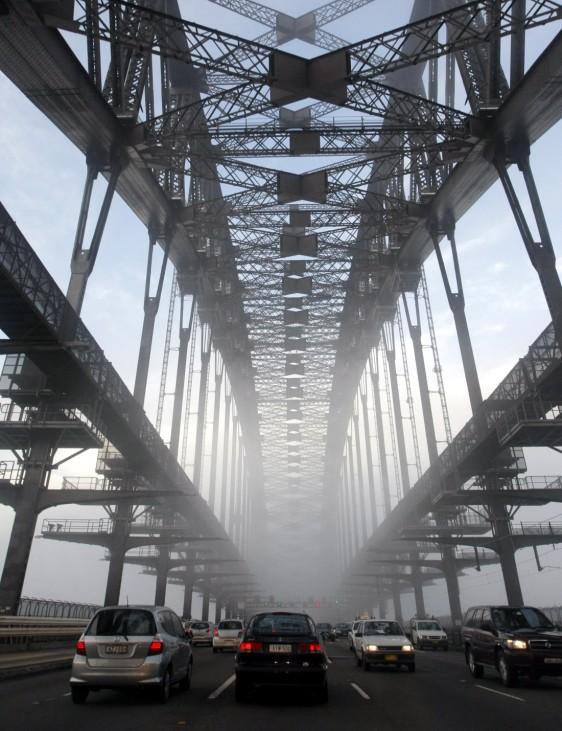 Fog slows peak-hour traffic on the Sydney Harbour Bridge