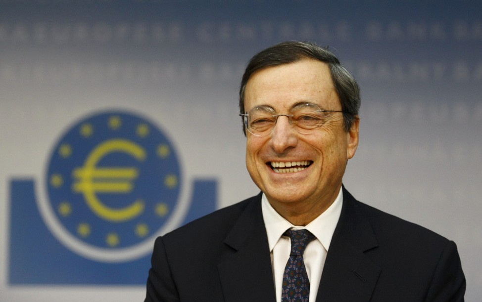 The European Central Bank President Draghi reacts during his first news conference in Frankfurt