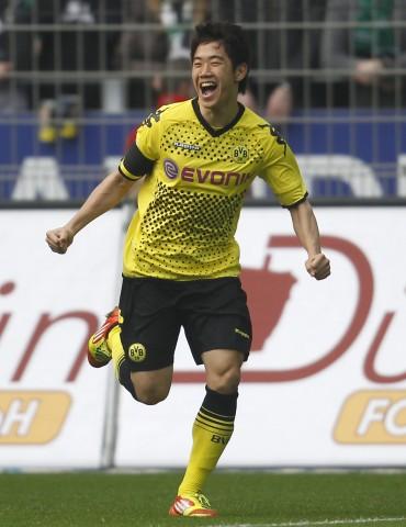 Borussia Dortmund's Kagawa celebrates a goal against Werder Bremen during the German first division Bundesliga soccer match in Dortmund