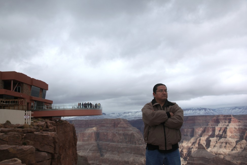 Waylon Honga, a member of the tribal council, is pictured at a skywalk extending out over the Grand Canyon and its incomplete building, on the Hualapai Indian Reservation Arizona