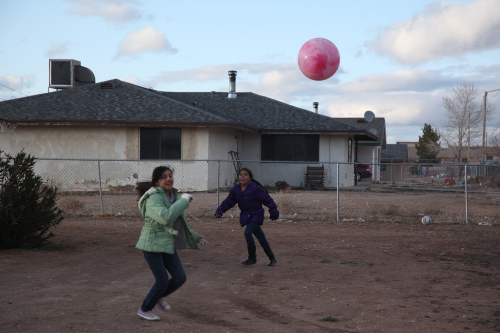 Children play in the yard of a home on the Hualapai Indian Reservation in Peach Springs, Arizona