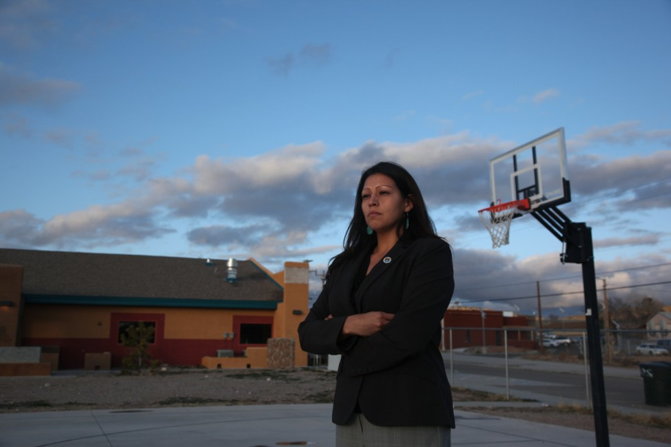 Candida Hunter, Hualapai Tribe councilwoman, poses for a photograph near new buildings on the Hualapai Indian Reservation in Peach Springs, Arizona