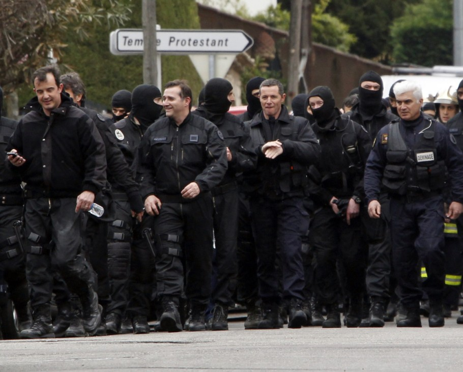 French special unit policemen leave after the assault to capture gunman Mohamed Merah during a raid on a five-storey building in Toulouse