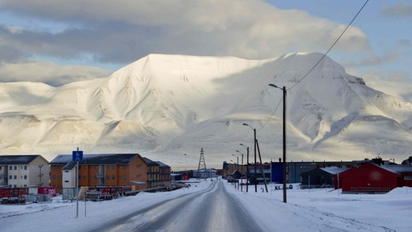 Town of Longyearbyen with the Hiortfjellet mountain in the background is seen in winter light in Svalbard