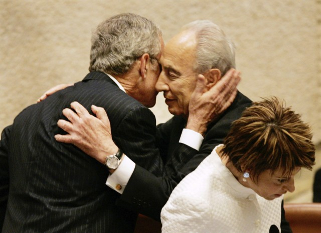 U.S. President Bush hugs Israeli President Shimon Peres after speaking to the Knesset in Jerusalem