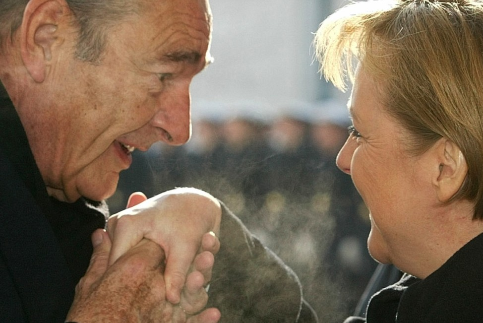 French President Chirac kisses the hand of German Chancellor Merkel upon his arrival at the chancellery in Berlin