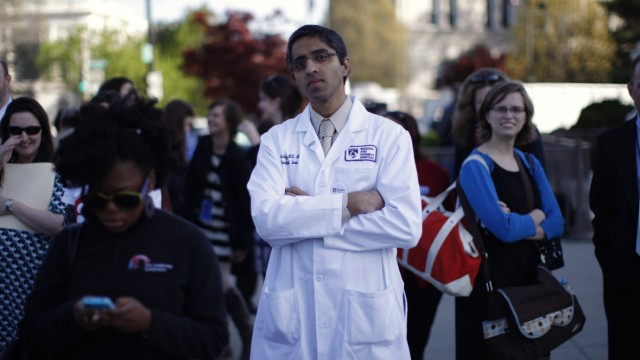 Doctor Murthy stands outside the Supreme Court during legal arguments over the Affordable Care Act in Washington