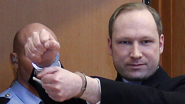 Norwegian Breivik, who killed 77 people, arrives at a court hearing in Oslo
