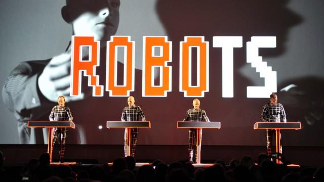 German electronic music band Kraftwerk perform their song 'The Robots' during the Kraftwerk - Retrospective 1 2 3 4 5 6 7 8 performance at the Museum of Modern Art in New York