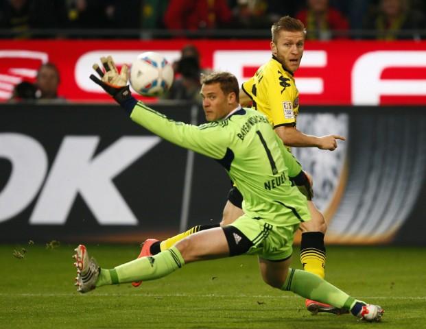 Blasczykowski of Borussia Dortmund attempts to score against goalkeeper Neuer of Bayern Munich during their German first division Bundesliga soccer match in Dortmund