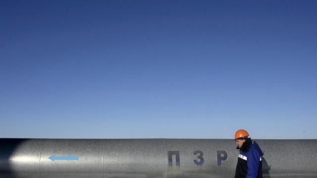 Employee walks at Russian gas export monopoly Gazprom's Sudzha pumping station