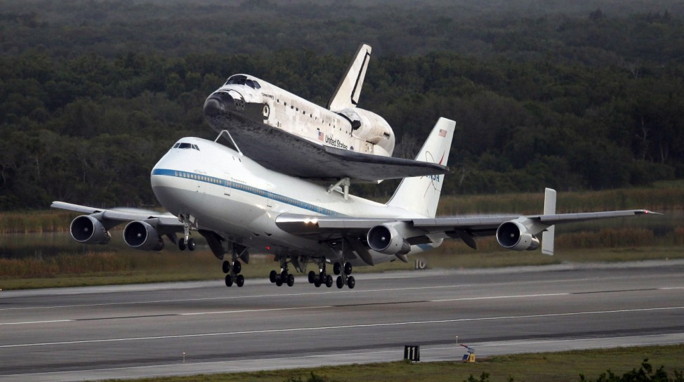 The space shuttle Discovery, attached to a modified NASA 747 aircraft, takes off headed for it's final home at The Smithsonian National Air and Space Museum from Cape Canaveral