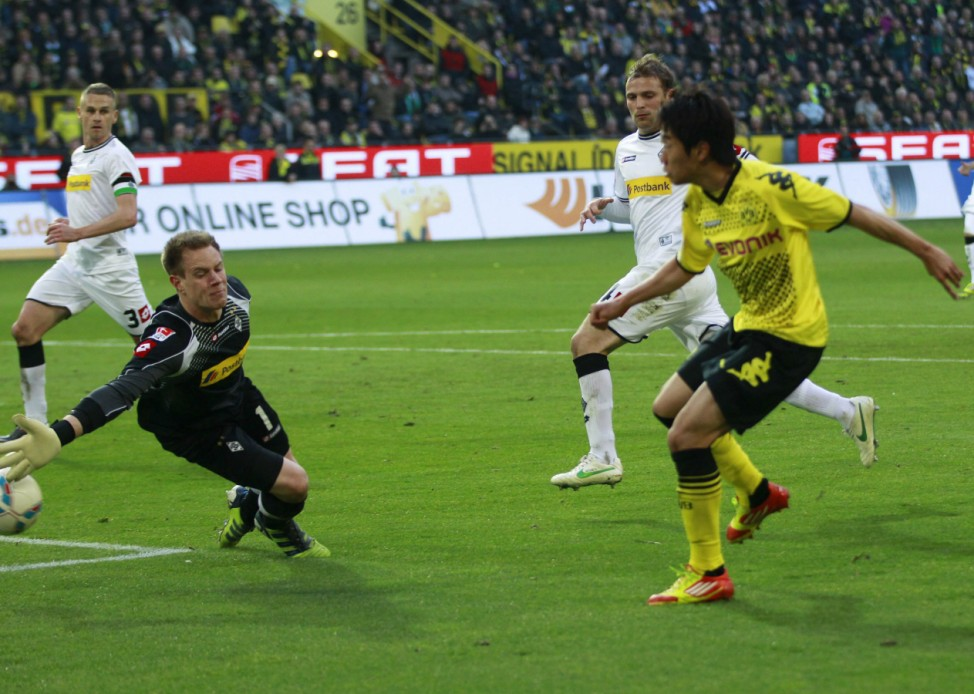 Borussia Dortmund's Kagawa scores a goal against Borussia Moenchengladbach during their German first division Bundesliga soccer match n Dortmund