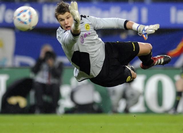 Borussia Dortmund's goalkeeper Langerak makes a save during their German Bundesliga first division soccer match against Hamburger SV in Hamburg,