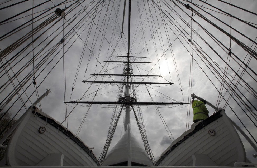 Shipwright Kevin Finch works on one of the lifeboats on the clipper Cutty Sark a day before it is due to be officially reopened by Britain's Queen Elizabeth, in Greenwich, South East London