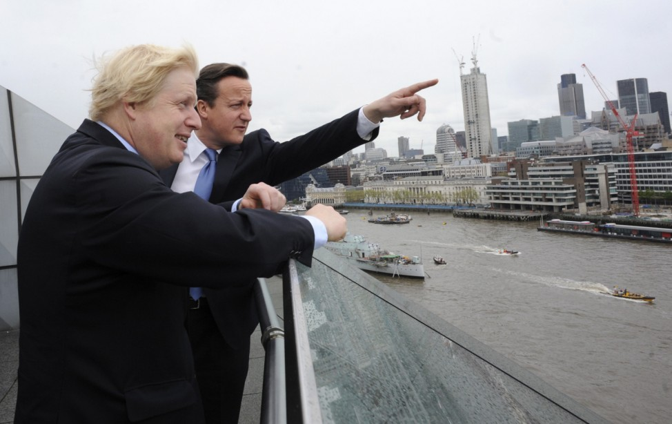 Britain's Prime Minister David Cameron and London Mayor Boris Johnson stand on a balcony at City Hall in central London
