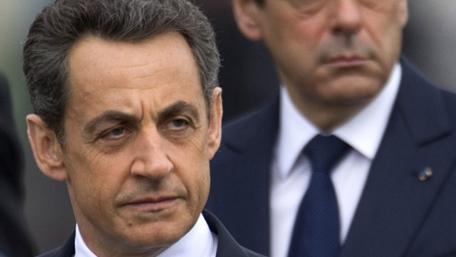 Outgoing French President Sarkozy and PM Fillon attend ceremony at Tomb of Unknown Soldier at Arc de Triomphe to commemorate end of World War II, in Paris
