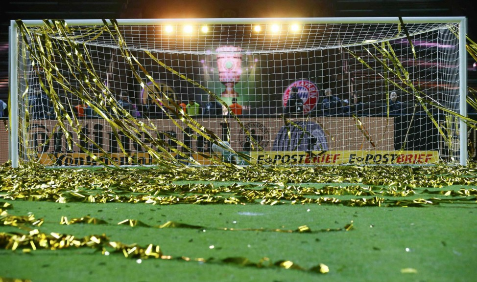 The empty pitch littered with confettii and tape is pictured after German DFB Cup final soccer match between Bayern Munich and Borussia Dortmund in Berlin