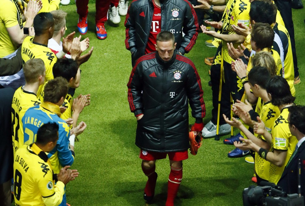 Bayern Munich's Ribery walks past Borussia Dortmund players after their German DFB Cup (DFB Pokal) final soccer match in Berlin