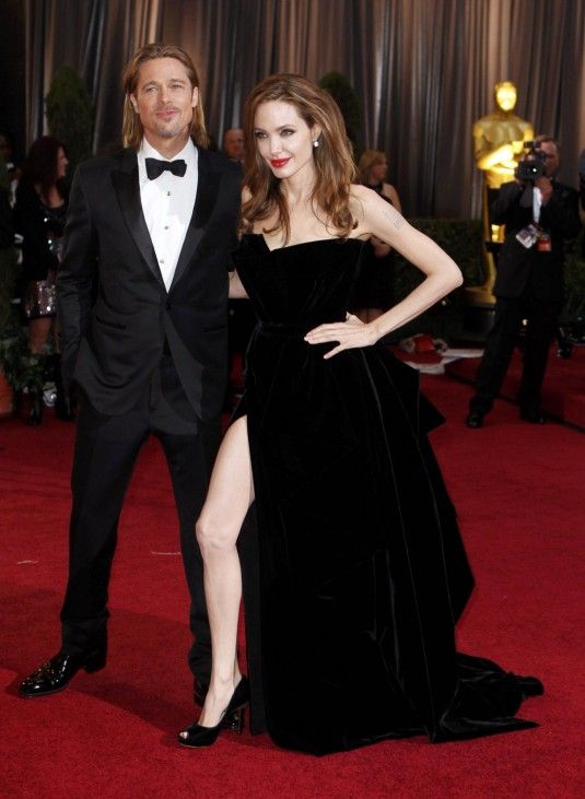 Actor Brad Pitt and his partner actress Angelina Jolie walk the red carpet at the 84th Academy Awards in Hollywood