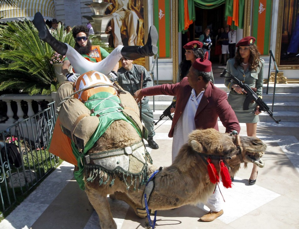 British actor Baron Cohen sits on a camel during a photocall on the Croisette in Cannes