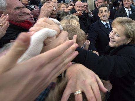 Angela Merkel, Nicolas Sarkozy;AFP