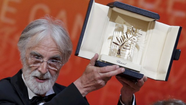 Director Haneke reacts after receiving the Palme d'Or award for the film Amour during the awards ceremony of the 65th Cannes Film Festival