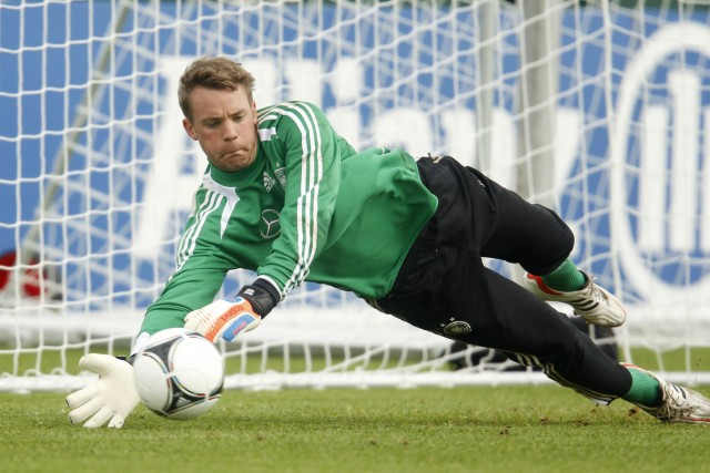 German national soccer player Neuer jumps for a ball during a training session in Tourrettes