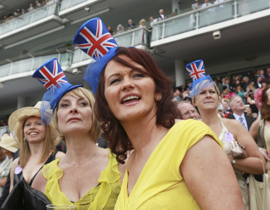 Racegoers watch the racing on Ladies Day during the Epsom Derby festival in Epsom