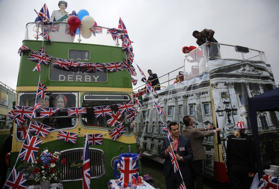 A double decker bus is clad with the facade of Buckingham Palace at the Epsom Derby festival in Epsom, southwest of London