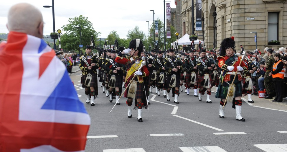 A parade of 1,000 pipers march through Perth, Scotland