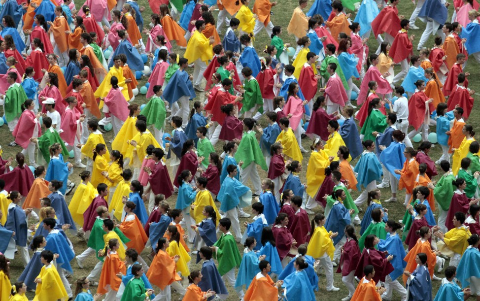 Performers dance during a meeting with Pope Benedict XVI at the San Siro stadium in Milan