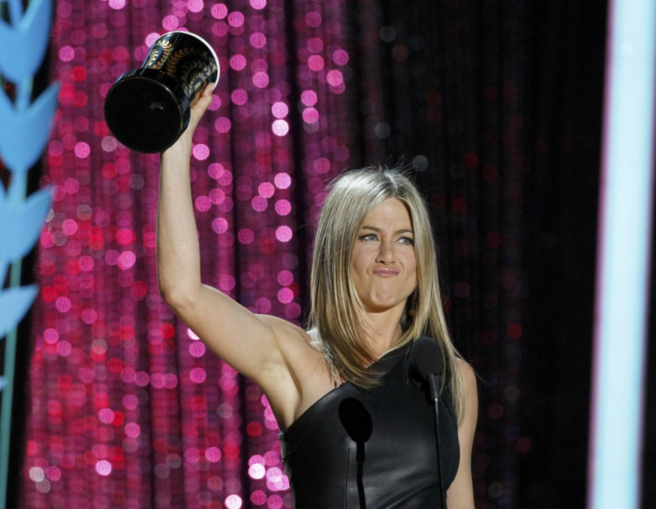 Actress Jennifer Aniston accepts the award for best on-screen dirtbag for her role in 'Horrible Bosses' at the 2012 MTV Movie Awards in Los Angeles