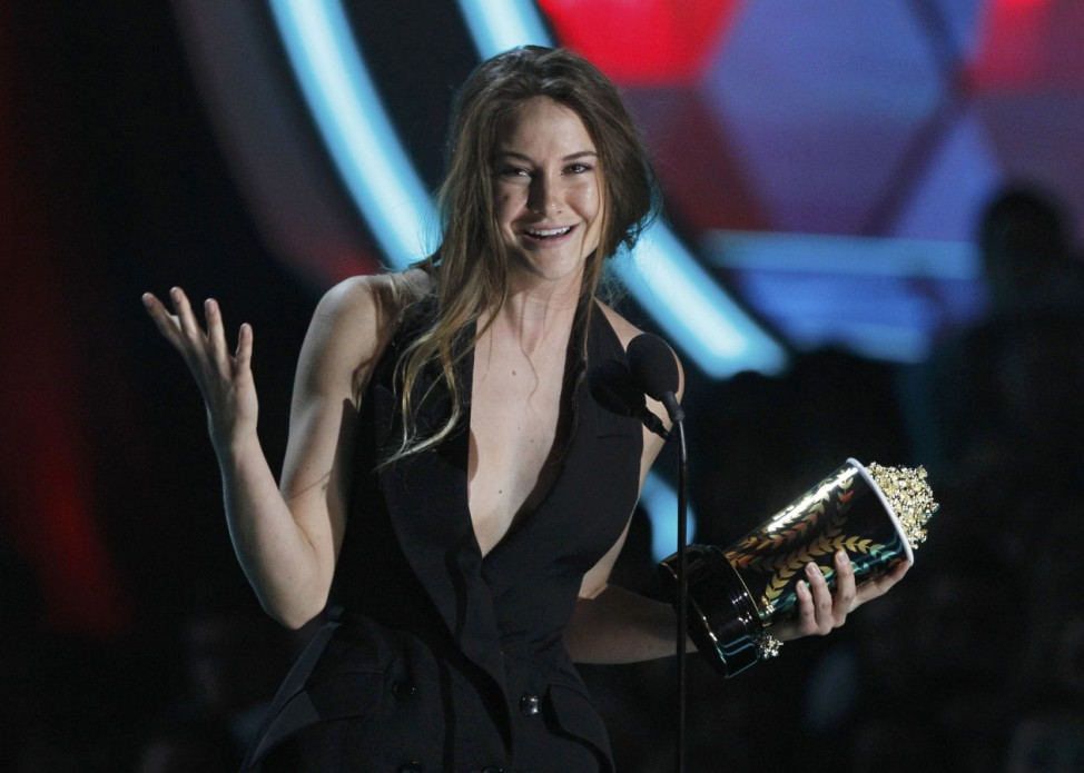 Actress Shailene Woodley accepts the award for breakthrough performance for her role in 'The Descendants' at the 2012 MTV Movie Awards in Los Angeles