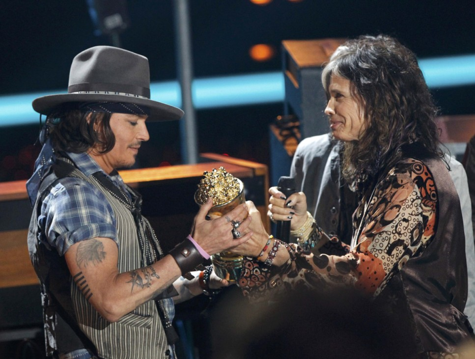 Steven Tyler presents the MTV Generation Award to actor Johnny Depp at the 2012 MTV Movie Awards in Los Angeles