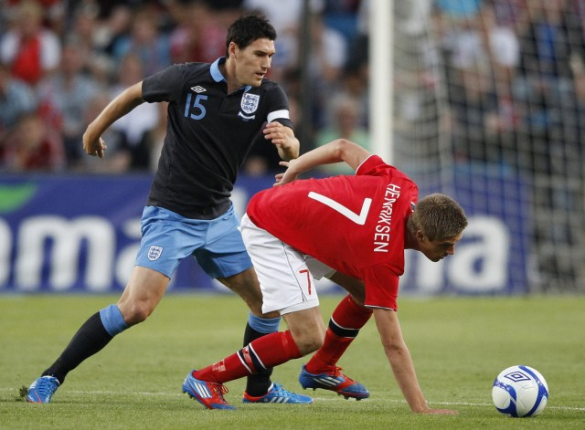 England's Barry challenges Norway's Henriksen during their international friendly soccer match at the Ullevaal Stadium in Oslo