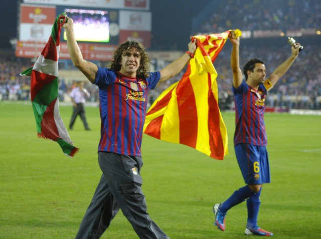 Barcelona's Puyol and Hernandez carry flags after winning the Spanish King's Cup final against Athletic Bilbao in Madrid