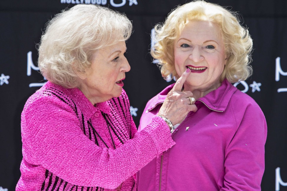 Betty White touches the lips of her wax figure during the unveiling at Madame Tussauds Hollywood wax museum in Los Angeles, California